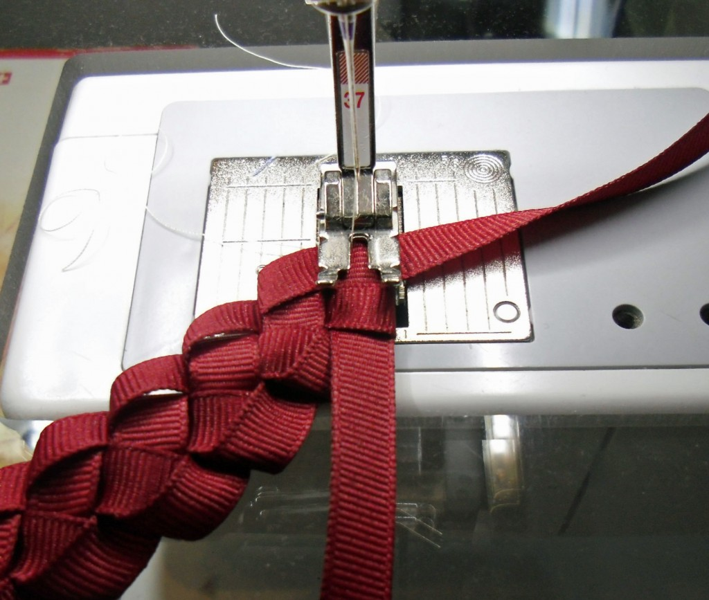 joy ribbon wreath being stitched