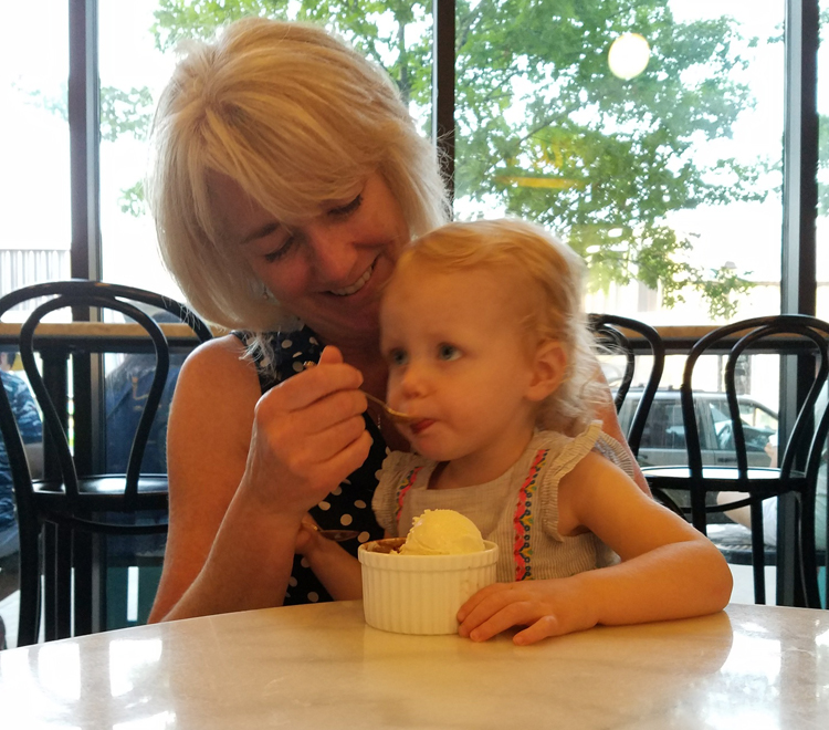 Amelia and grandma sharing ice cream