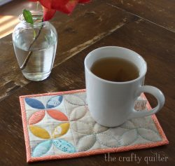 Orange Peel Mug Rug tutorial @ The Crafty Quilter. It makes the perfect gift!