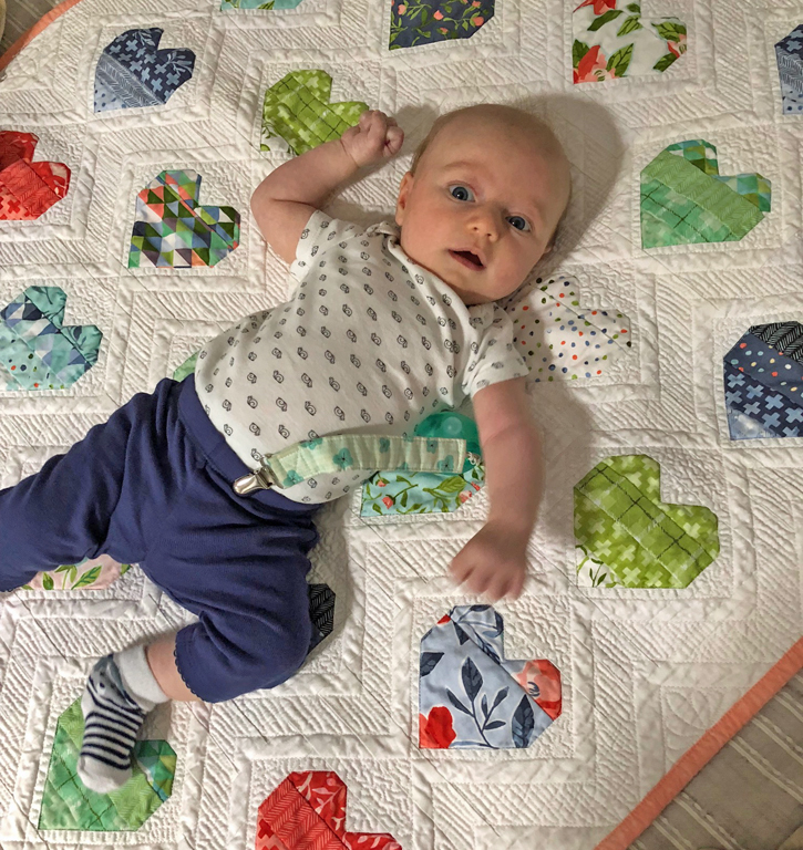 Ombre Hearts baby quilt by Julie Cefalu @ The Crafty Quilter