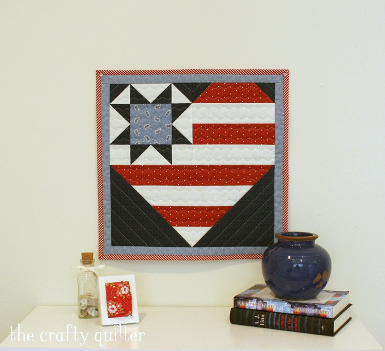 Star Spangled Heart pattern by Julie Cefalu @ The Crafty Quilter. It includes two different size options and layouts for a table runner and wall hanging.