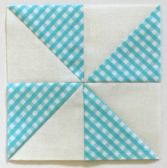 "Summer Fun Quilt Along @ The Crafty Quilter features a bright and happy wall hanging that measures 30"" x 32"". Week 2 instructions include the pinwheel blocks and beach ball blocks."