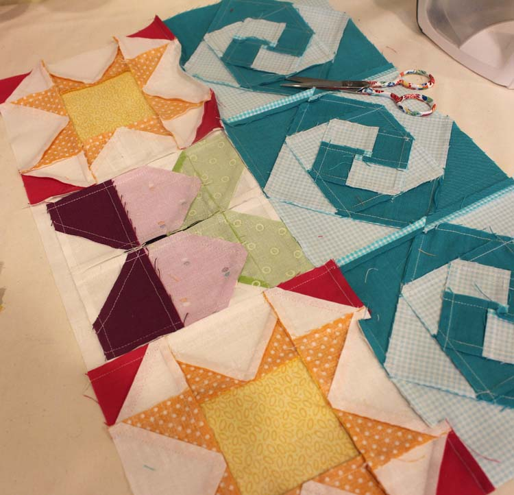 "The Summer Fun Quilt Along @ The Crafty Quilter creates a bright and happy wall hanging that measures 30"" x 32"". Week 5 instructions include the SUMMER applique section and finishing instructions."