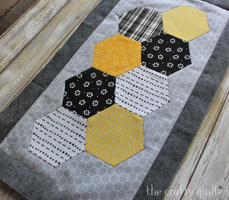 Month 3 of the Save The Bees BOM by Jacquelynne Steves. This block is made by Julie Cefalu @ The Crafty Quilter using machine pieced hexagons and invisible applique.