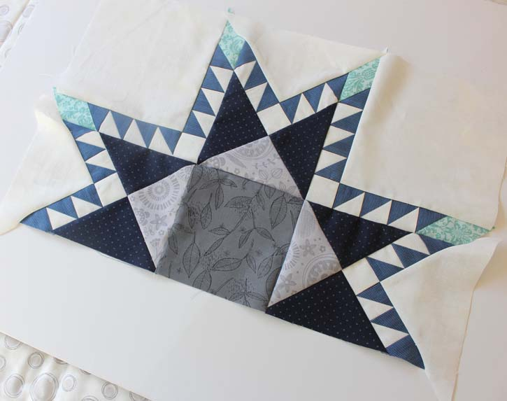 Partial feathered star block made by Julie Cefalu @ The Crafty Quilter