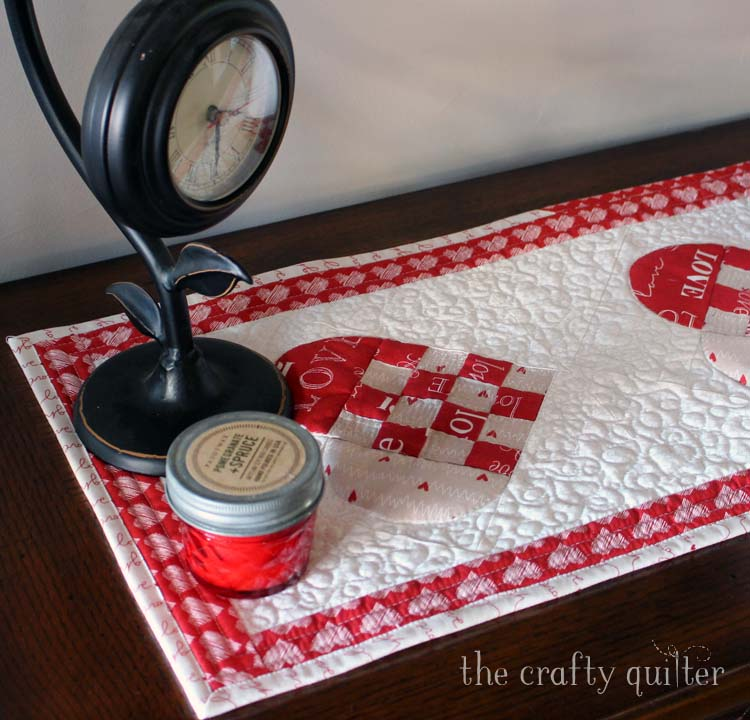 Woven Hearts Table Runner designed and made by Julie Cefalu @ The Crafty Quilter